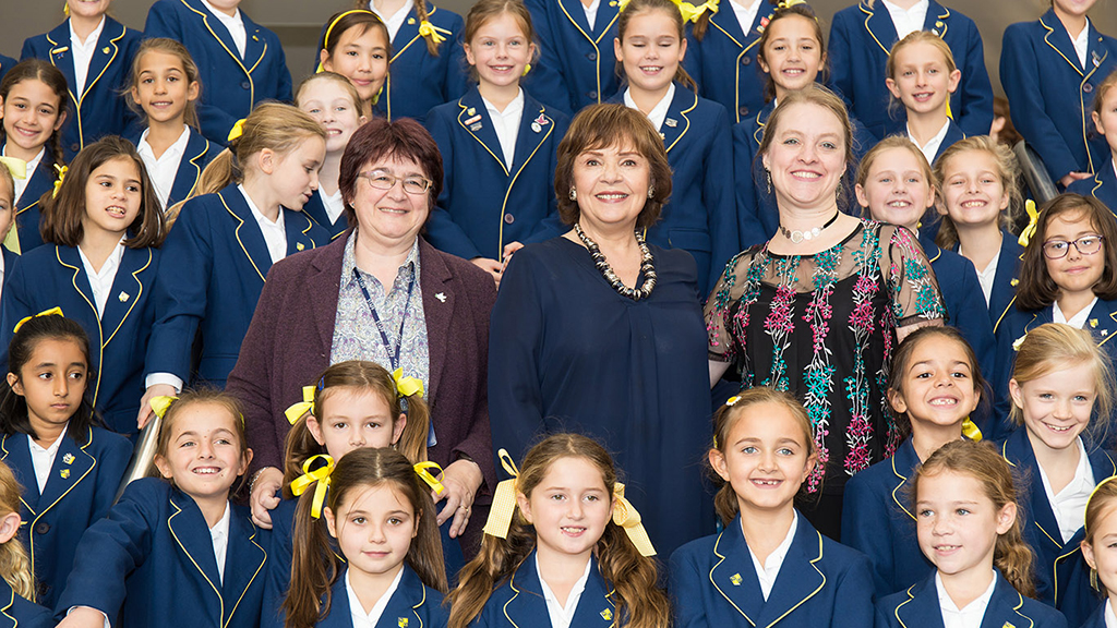 Dana with the 55-strong choir from Notre Dame School Cobham