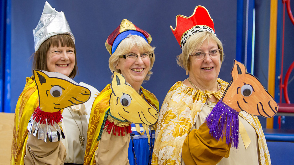 Photo of Open the Book team members dressed as the three wise men