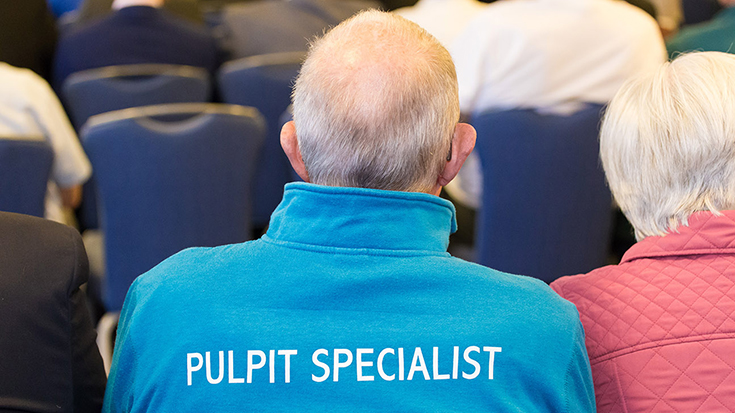 Photo of man wearing pulpit specialist top