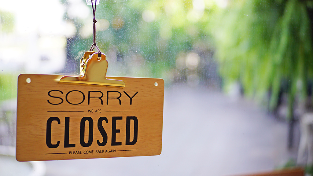 Photo of shop sign saying sorry we are closed