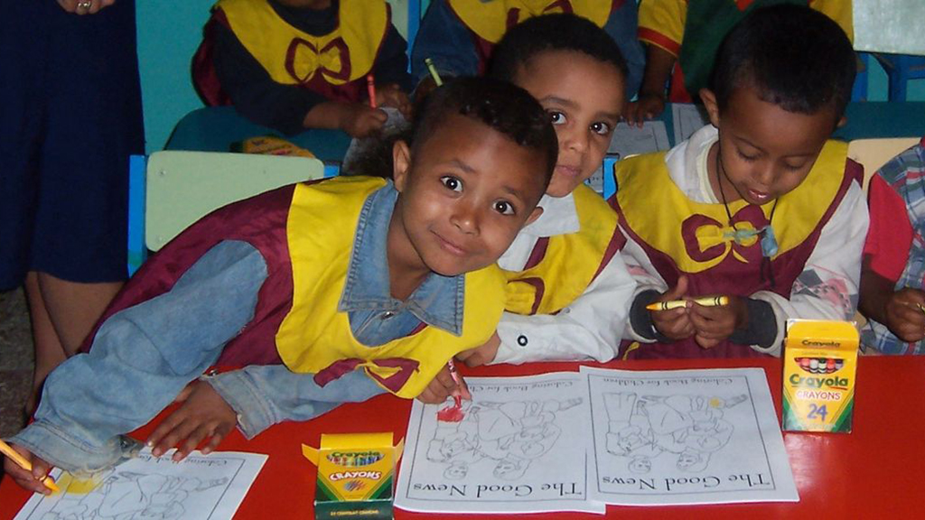 Photo of kids with colouring books