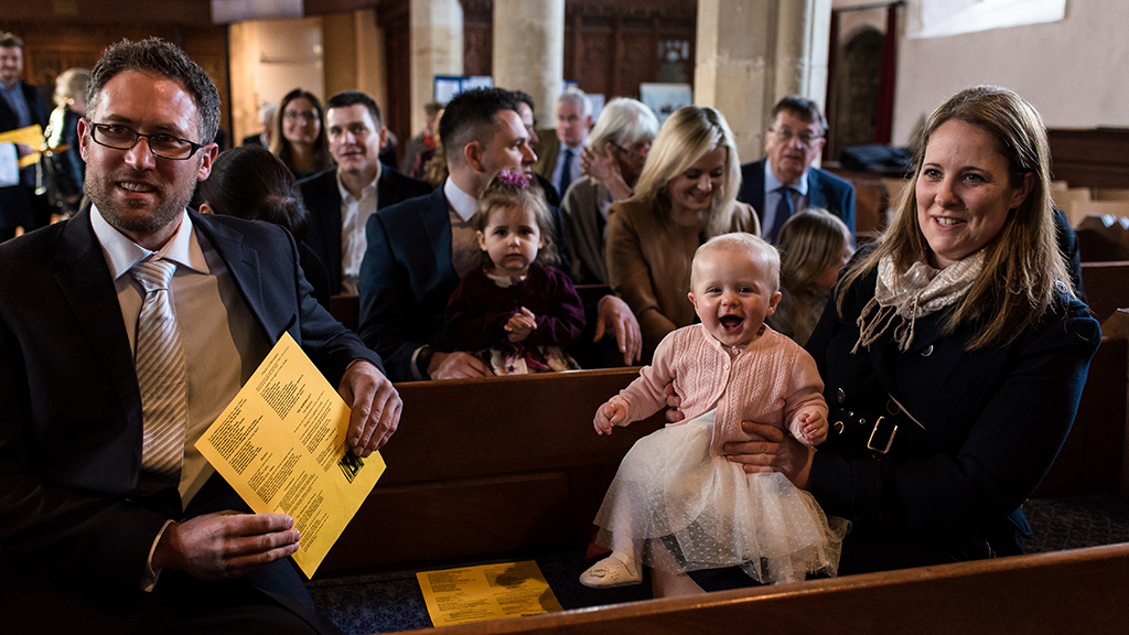 Photo of people in church at a wedding - credit HelenBatt Photography