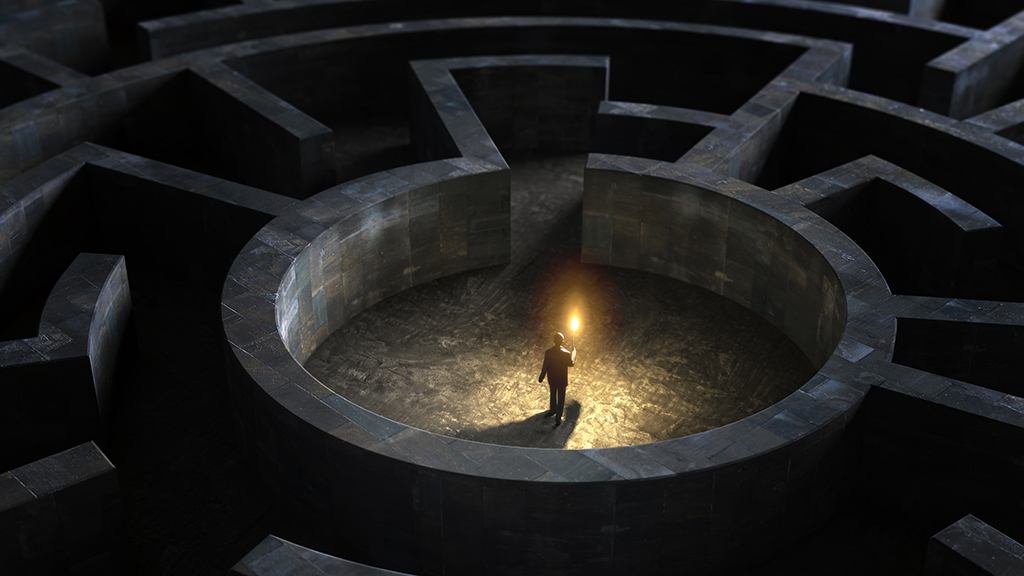 Illustration of man with candle at centre of a dark maze