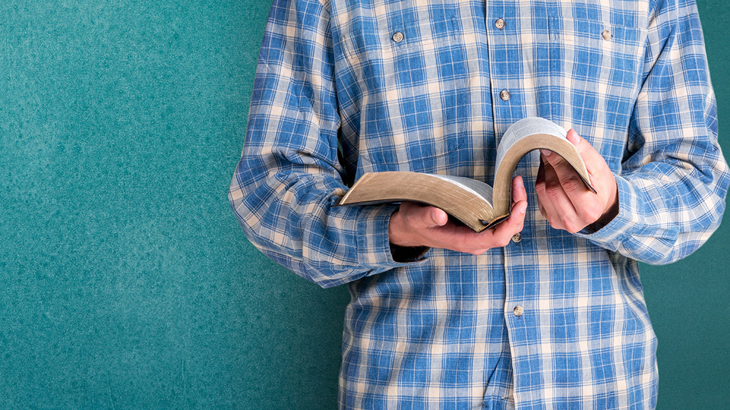 Photo of a young man with a Bible