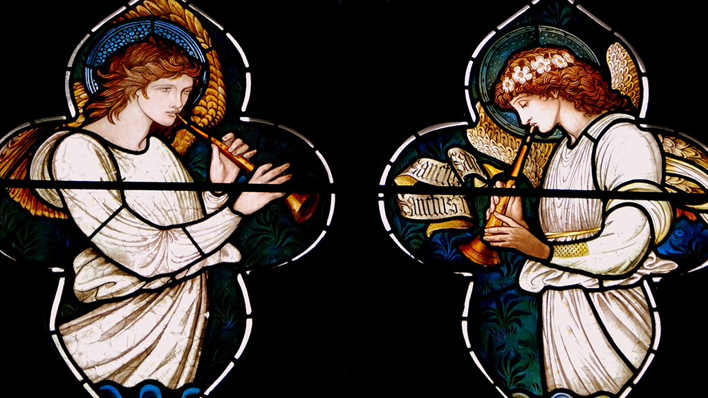 Photo of stained glass angels playing trumpets