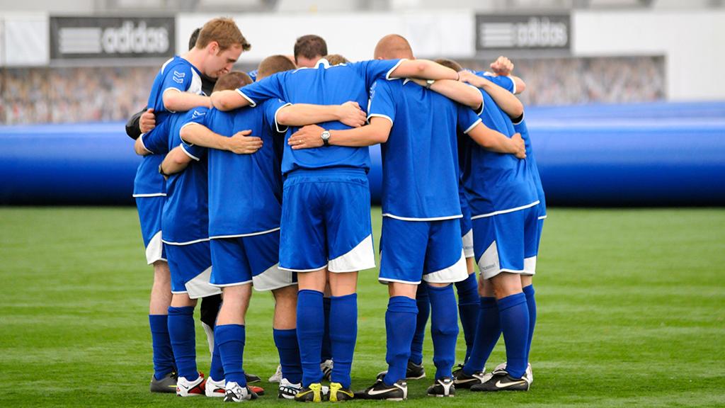 photo of football prayer huddle