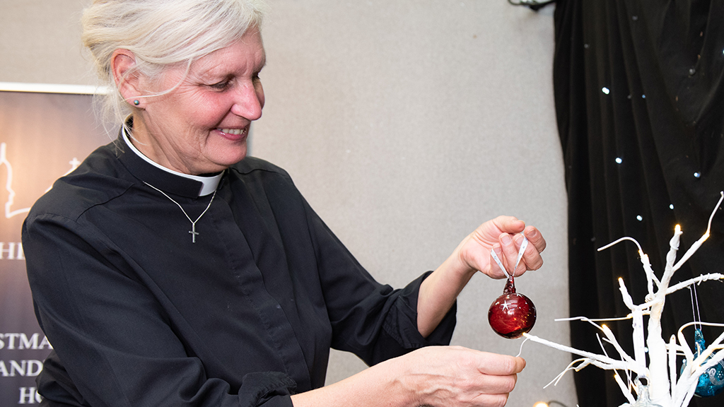 Photo of Ros Pollock with a Bethlehem Bauble